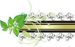 Tadelloser Sprig auf dem Hintergrund der dekorativen Fahne Stockfotografie