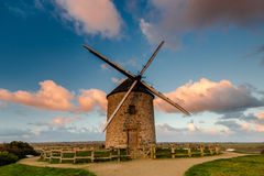 Taditional ancient windmill in France. Stock Photos