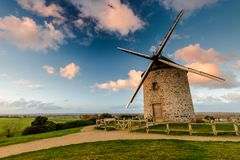 Taditional ancient windmill in France. Taditional ancient windmill Moidrey in scenic fields on hill top in Pontorson,France Stock Images