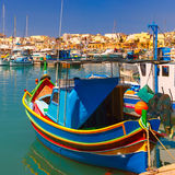 Taditional eyed boats Luzzu in Marsaxlokk, Malta. Traditional eyed colorful boats Luzzu in the Harbor of Mediterranean fishing village Marsaxlokk, Malta Stock Images