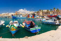 Taditional eyed boats Luzzu in Marsaxlokk, Malta. Traditional eyed colorful boats Luzzu in the Harbor of Mediterranean fishing village Marsaxlokk, Malta Royalty Free Stock Photo