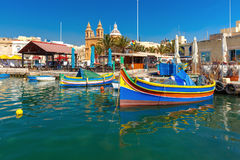 Taditional eyed boats Luzzu in Marsaxlokk, Malta. Traditional eyed colorful boats Luzzu in the Harbor of Mediterranean fishing village Marsaxlokk, Malta Royalty Free Stock Images
