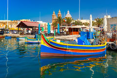 Taditional eyed boats Luzzu in Marsaxlokk, Malta. Traditional eyed colorful boats Luzzu in the Harbor of Mediterranean fishing village Marsaxlokk, Malta Royalty Free Stock Photography