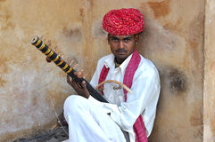 Taditional Rajasthani man playing Ravanahatha musi. Rajasthani man playing Ravanahatha. It is an is an ancient bowed fiddle musical instrument. It is once Royalty Free Stock Photo