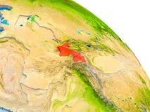 Tadschikistan im roten Modell von Erde Stockfotos
