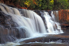 Tadtone waterfall in tropical rain forest Stock Photo