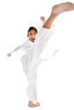 Tae Kwon Do Asian girl on white background. Royalty Free Stock Photo
