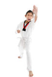 Tae Kwon Do Asian girl on white background. Stock Photo