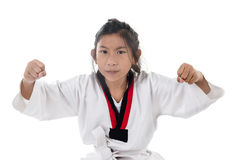 Tae Kwon Do Asian girl on white background. Royalty Free Stock Image