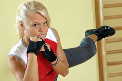 Taebo kick. Young attractive woman, excercising in gym Stock Photo