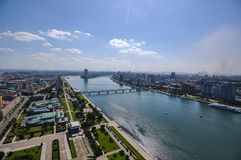 Taedong river and bridge and Pyongyang cityscape royalty free stock photos