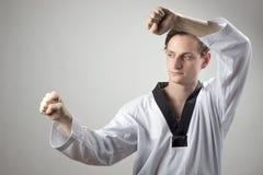 Taekwon-Do defense. Taekwon-Do black belt champion is doing a defense block Royalty Free Stock Image