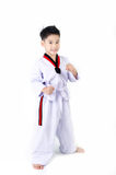 Taekwondo action  by a asian cute boy Royalty Free Stock Photography