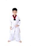 Taekwondo action  by a asian cute boy Royalty Free Stock Photo