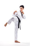 Taekwondo action. By a young man royalty free stock images