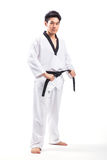 Taekwondo action. By a young man royalty free stock photography