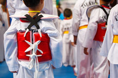 Taekwondo athlete in white uniform with armour Stock Photos