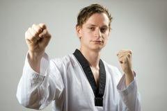 Taekwondo-Doppeltblock Lizenzfreie Stockfotos