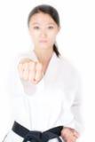 Taekwondo fist. Closeup taekwondo athlete fist. Blur people's faces Royalty Free Stock Photo