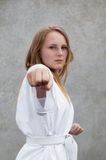Taekwondo martial art. Young woman practising taekwon-do stock images