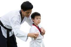 Teacher Black belt Taekwondo Fighter Kid Punch Guard Stand for Flight. Taekwondo master black belt teaching kid to fight guard on white background royalty free stock photos