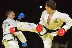 Taekwondo match Adlan Bisayev vs Evgeny Otsimik Royaltyfri Fotografi