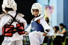 Taekwondo Tournament. Kids as young as 7 years old participating in a Taekwondo tournament. Penang Inter School Taekwondo Championship (TM/WTF) 2013 Stock Photography