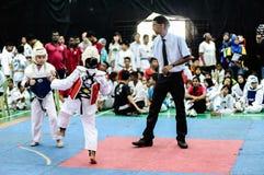 Taekwondo Tournament. Kids as young as 7 years old participating in a Taekwondo tournament. Penang Inter School Taekwondo Championship (TM/WTF) 2013 Stock Photo