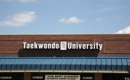 Taekwondo University. Instructs people in the ancient form of martial arts and other forms of hand to hand combat Royalty Free Stock Photo