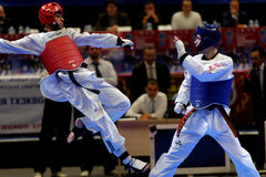 Taekwondo WTF match Russia vs Iran. St. Petersburg, Russia - October 17, 2015: Taekwondo WTF junior teams match Russia vs Iran during the martial arts festival stock image