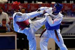 Taekwondo WTF match Russia vs Iran. St. Petersburg, Russia - October 17, 2015: Taekwondo WTF junior teams match Russia vs Iran during the martial arts festival stock photography