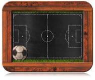Tafel mit Fußballplatz und Ball Stockbild