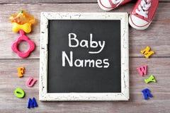 Tafel mit Text BABY-NAMEN stockfotografie