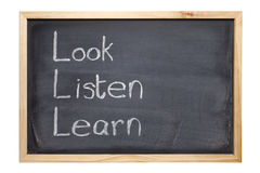 Tafel mit Wörtern, die Blick hören, erlernen lizenzfreie stockfotos