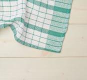 Tafelkleed of handdoek over de houten lijst Royalty-vrije Stock Afbeeldingen