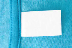 Tag. Blank tag on a blue piece of clothing stock photo