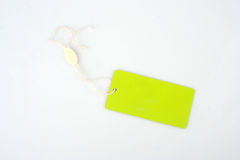 Tag. Black empty tag with a green cord isolated on a white background Stock Images