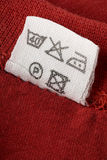 Tag. A washing instruction tag on a red t-shirt Royalty Free Stock Image