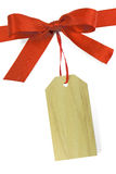 Tag. Blank gift wood tag tied with a bow of red satin ribbon. Isolated on white, with soft shadow Royalty Free Stock Image