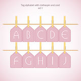 Tag alphabet with clothespin and cord Stock Photo