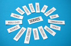 SERVICE paper tag cloud on blue background. Tag cloud on the theme of SERVICE composed of rectangular pieces of paper with words printed on them. Landscape stock images