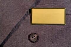 Tag conhecido em branco no terno de negócio Imagens de Stock