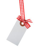 Tag decorated with ribbon Royalty Free Stock Images