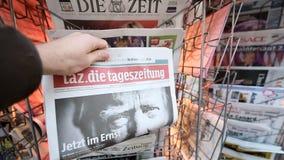 Tag Die Tageszeitung Donald Trump new USA president. PARIS, FRANCE - NOV 10, 2016: Man buying German newspaper Tag Die Tageszeitung with shocking headline title stock footage