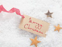 Tag do presente com o Feliz Natal que cumprimenta Imagem de Stock