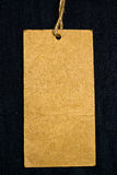 Tag em branco em calças de brim imagens de stock