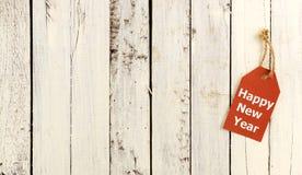 Tag - guten Rutsch ins Neue Jahr auf rotem Papier auf hölzernem Stockfotografie
