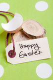 Tag With Happy Easter. Easter image with broken egg shell and threade tag saying Happy Easter Royalty Free Stock Photography