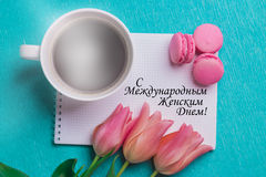 Tag happy international women's day and three pink tulips. Tag happy international women's day in russian and three pink tulips, a cup of coffee and three pink Stock Photography