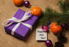 Tag Happy New Year, gift, postcard and Christmas decorations Royalty Free Stock Photo